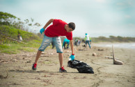 Volunteers picking up plastic bottles in Laguna de Las Salinas