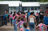 Children affected by the volcanic eruption of June 3, 2018, beginning their school day in the shelter of the La Industria farm, Escuintla of the Republic of Guatemala.