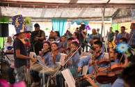 Children of the hostel participate as a director in charge of the OSEMAP orchestra.